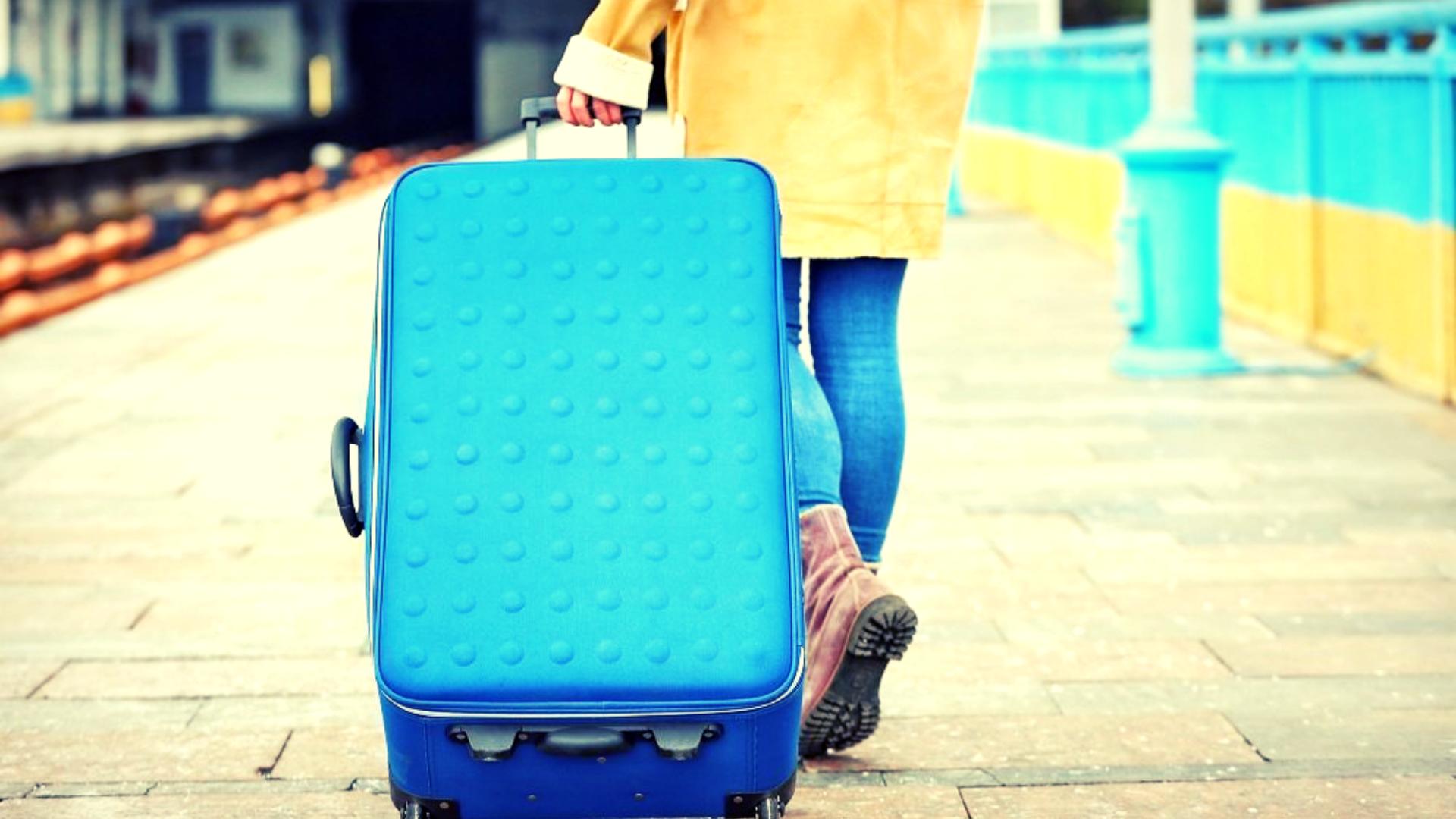 зачем нужен чехол на чемодан